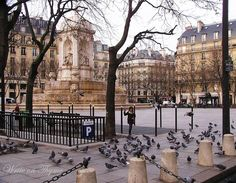 PLACE SAINT SULPICE ~ One of the loveliest squares in PARIS. A delightful place to sit at a café, and take in the views of the fountain, and watch the people go by.