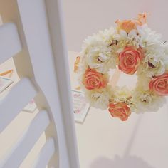 DIY silk flower nursery mobile in peach, coral and whites.