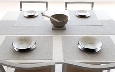 Chilewich's new textiles collection is all about casual elegance. Pictured: Chilewich rectangle placemats and runner in mist boucle.