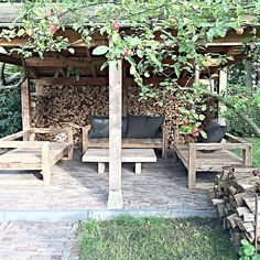 Stacked wood for privacy wall under pergola.