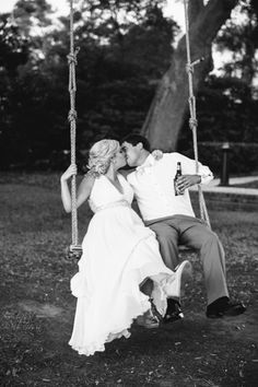 Bride + Groom Kissing on Swing // Colorful Lilly Pulitzer Inspired Wedding at Lowndes Grove in Charleston SC // Dana Cubbage Weddings // Charleston SC + Destination Wedding Photographer