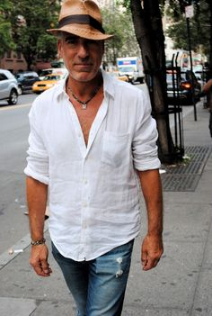 a simple linen white shirt. could match perfectly with coloured denim shorts