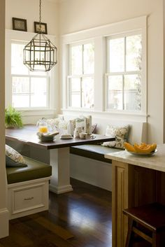 Seems silly to have both a kitchen table & a dining room table. Instead, have a built-in banquet in the breakfast nook...great place for writing up the shopping list, menu planning, or kid's homework.