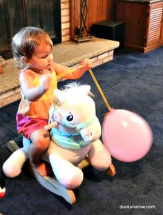 Miss N just LOVES her fairy tale Carousel Horse plush toy rocker from RockAbye. http;/www.rockabye.com #toys #babies #toddler