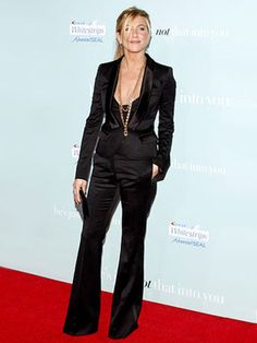 Jennifer Aniston working it in a menswear-inspired pant suit