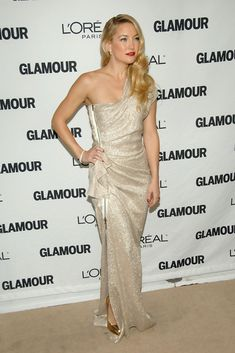 Kate Hudson Evening Dress - Kate exudes old Hollywood glamour in this shimmering Lanvin gown. Her soft blond ringlets with a dramatic side part add to the classic feel. Bright red lips and gold heels complete the look. The side zip is Lanvin's touch to make this throw back style uniquely modern.
