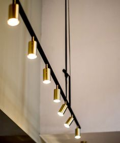 Long John pendant light designed by Niclas Hoflin for Rubn. All lamps are manufactured by hand in Sweden, with great attention to detail, functionality and aesthetics. The designs adapt to today's technology, style and needs, but are solidly rooted in the delights of the past. White, Matt black or Brass bar with Brass shades. 360 degree swivel in raw brass. Textile cord in black. White textile cord on white model. 2.5m suspension strap in choice of Black, Brown or Light Brown leather. 5 ...