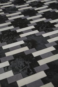 "Edelman Leather ""Lattice"" cowhide rug in Black, Bianco and Banker's Grey."