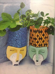 Plastic bottle planters - reuse soft drink bottle by cutting, sanding, painting, newspaper, potting mix, plants...