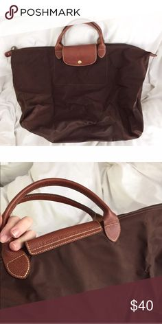 Travel Size Brown Longchamp Gently used. Minor signs of wear. Perfect for a weekend away! Made in France. Longchamp Bags Travel Bags