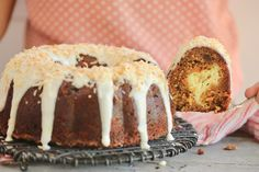 A slice of carrot cake Bundt Cake being removed, showing the cream cheesecake filling inside. Carrot Cake Bundt, Carrot Cake Cheesecake, Bundt Cakes, Cheesecake Recipes, Cream Cheese Glaze, Cake With Cream Cheese, Bigger Bolder Baking, Big Cakes, Cake Cover