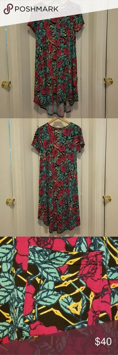 LuLaRoe Rose Print Carly NWT This print is stunning rose with leaves and gold accents. Perfect for all seasons!   New with tags! LuLaRoe Dresses