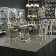Aico Amini Hollywood Swank 9 Piece Trestle Dining Table and Chair Set by Aico Amini. $5520.00. Pearl. Purchase Includes: Hollywood Swank 9 Piece Trestle Dining Table and Chair Set Only. Dining Table, 2 Arm & 6 Side Chairs. You'll have an exquisite addition to your dining room decor with Aico Amini Hollywood Swank 9 Piece Trestle Dining Set. The rectangle-shaped table carries a platinum finished base with beautiful cabriole legs and a cavier finished top. Plus, glass top...
