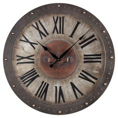 Distressed+metal+wall+clock+with+Roman+numerals+and+copper+accents.+  Product:+Wall+clockConstruction+Material:+Metal