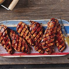 Slather this tender chicken with barbecue sauce before it comes off the grill for a quick take on slow-cooked barbecued chicken.
