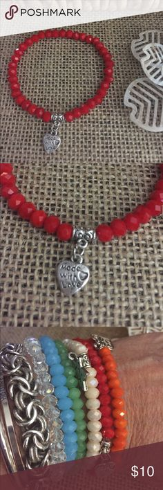 Red Glass Stretch Bracelet Red glass Bead Stretch bracelet with a heart charm that says made with love ❤️ Add to your stack or start your stack today !  The charm is metal alloy with Rhodium plating.  I have several colors listed, bundle and save!  Z05 Jewelry Bracelets
