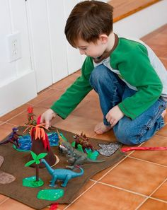 How To: Dinosaur Play Mat - this one's a little overdone, but the volcano and trees are pretty cool.