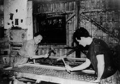 Patounis' Olive Soap, Corfu, Greece - old photo of workers stamping soap