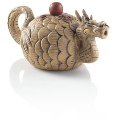 This beautifully detailed teapot forms a dragon with its mouth as the tea spout. Dragons symbolize power and strength, and when designed this beautifully, they engender conversation. Made from Yixing clay.