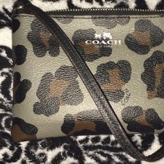 New cheetah print Coach wristlet Bought winter 2016 from Coach in Atlantic City, NJ. Interior is black with pockets. Fits iPhone. No blemishes. Suthentic, durable leather. Super cute with a currently sold print Coach Bags Clutches & Wristlets