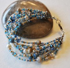 9 Strand Petoskey Stone and Leland Blue Bracelet with by Beechtree, $50.00