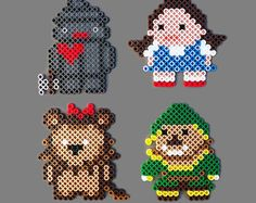 Wizard of Oz Perler Bead Magnet Set: Dorothy, Tinman, Scarecrow, Lion -- There's no place like home to hang these geekcraft magnets.