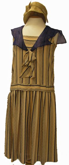 Cream and blue 1920s day dress.  Interesting take on sailor.  Note sheerness of collar, and directionality of stripes.