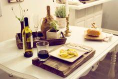 love the idea of using a rustic piece of wood as a plate charger