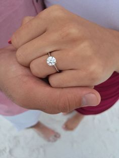 My ring! Four prong, solitaire 1.2 carat flawless (VS) round cut diamond -