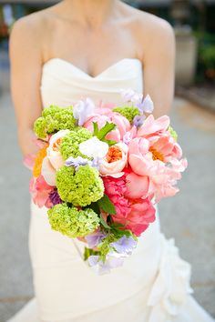 The perfect summery wedding bouquet for the bride!  Photography via @Emily Wren