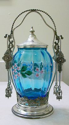 Here is a very nice Victorian Pickle Castor with a beautiful blue jar with enameled flowers. The silver plating company is Victor Silver and is quadruple plated.