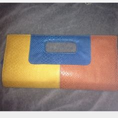 """Color-block envelope clutch Faux snake skin/leather envelope style clutch measures about 13"""" wide and 7"""" high. Inside has a card slot & magnetic snap closure. Bag was never used. Pet & smoke free. Also on Ⓜ️ Bags"""