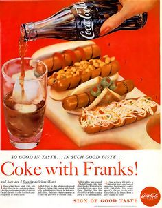 A classic glass of Coke served up with four creatively decorated hot dogs. More Olives! YUCK!