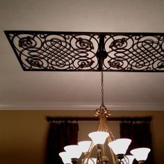 Metal decor over dining room table.