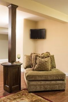 A useful idea for those unsightly poles in your basement.  Let us help you make your basement more inviting!