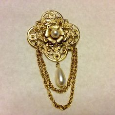 A personal favorite from my Etsy shop https://www.etsy.com/listing/278974386/vintage-chatelain-dangle-gold-metal-and