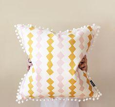 Zig Zag Warm Throw Cushion with White Pom Pom Trim by ZanaProducts