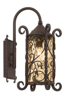 """Casa Seville™ Iron Scroll 18 1/2"""" High Outdoor Light by John Timberland. $139.99. Iron scroll outdoor lamp comes in a handsome dark walnut finish. Scroll accents and metal detailing is enhanced by the hammered Champagne glass. Add a touch of Spanish-style home fashion design to your outdoors.. Save 33% Off!"""
