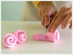 Google Image Result for http://www.make-fabulous-cakes.com/images/fondant-ribbon-roses-6.jpg