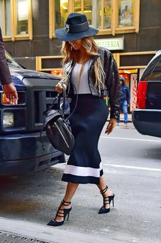 This black and white outfit is anything but boring—we love how she accessorized with a backpack, floppy hat and strappy heels.