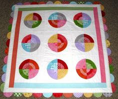 @Riley Blake has really hit the mark with this bullseye baby quilt. Combine fat quarter quilt patterns, fabric scraps, and more to make an easy baby quilt pattern with a lot of character.