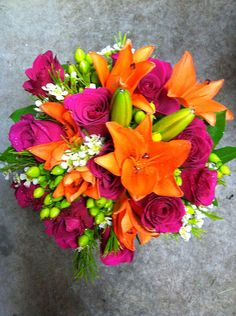 3) Hot Pink and Orange , accented with lime green – Roses, lilies and hypericum berries