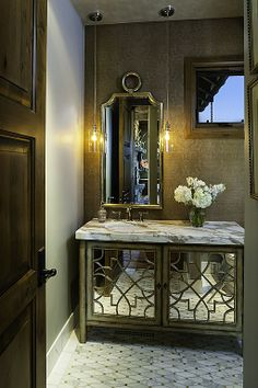 Traditional Powder Room. bathroom design. tiles, stone. marble. wallpaper, shower. bathtub. ceiling. lighting. glass. sanitary fittings and fixtures.. mirror