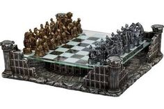 This themed chess set features an incredible glass chessboard that hovers over the Coliseum with pewter chessmen in bronze and silver, including a resin replica of the Roman amphitheater. A really cool set to display in any room!