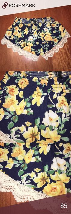 flowy and floral shorts Flowy floral shorts perfect for spring and summer!  It's navy blue with yellow flowers, and it has cute cuts at the bottom of the shorts.  Even though it's a size medium, it can fit petite and larger girls.  It's also flexible around the waist, in case you're worried it will be too snug for you.  There are no stains and looks perfectly new. Forever 21 Shorts Skorts