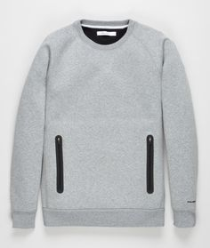 Regular fit cotton neoprene blend crewneck sweater with two bonded pockets and laser cut details throughout.