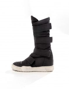 "I used to have a pair of plain white ""tech boots"" a lot like these. A little bizarrely, they were made by Esprit"