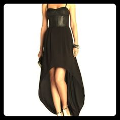 BCBGMAXAZRIA Black Leandra leather Bustier dress BRAND NEW WITH TAGS!! Bought for an event but never ended up going!  This style of dress is no longer available and sold out with BCBG.com.  A leather bustier meets flowing georgette for a breeze-catching dress w edge. Bustier-seam faux-leather bodice, ponte insets at back. Thin, adjustable shoulder straps. Chiffon skirt with ruching detail at waist. Curved, high-low hem. Concealed center back zipper with hook-and-eye closure. Faux Leather…