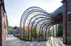 Thomas Heatherwick Studio built two intertwining glasshouses for Bombay Sapphire's distillery.