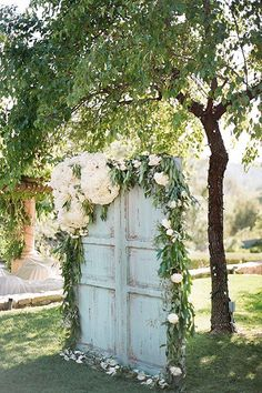 Garden wedding? Create aSecret Garden vibe by decking a wall or doorway with flowers and using it as your backdrop.